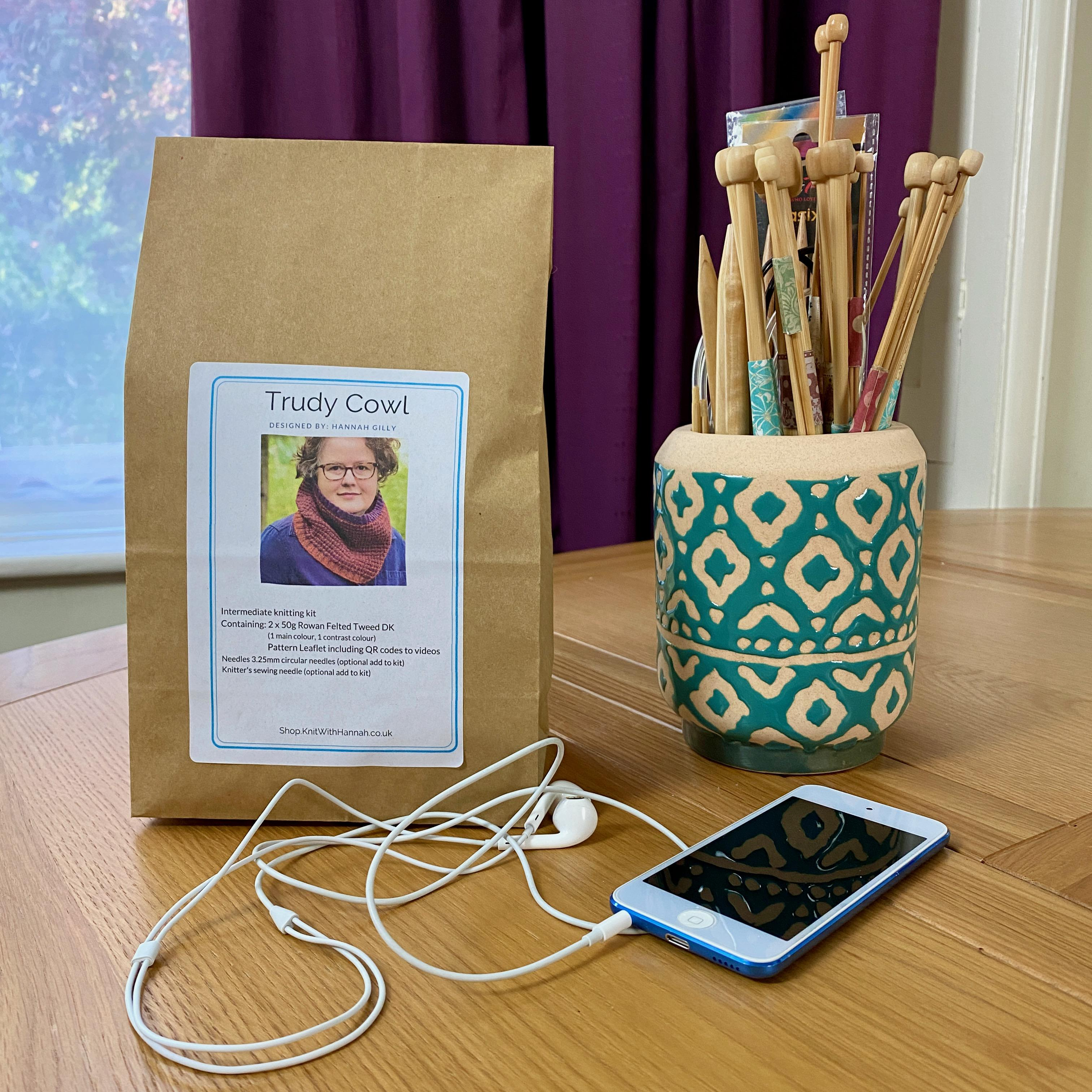 Trudy Cowl Knitting Kit in brown paper bag with jar of knitting needles and iPod