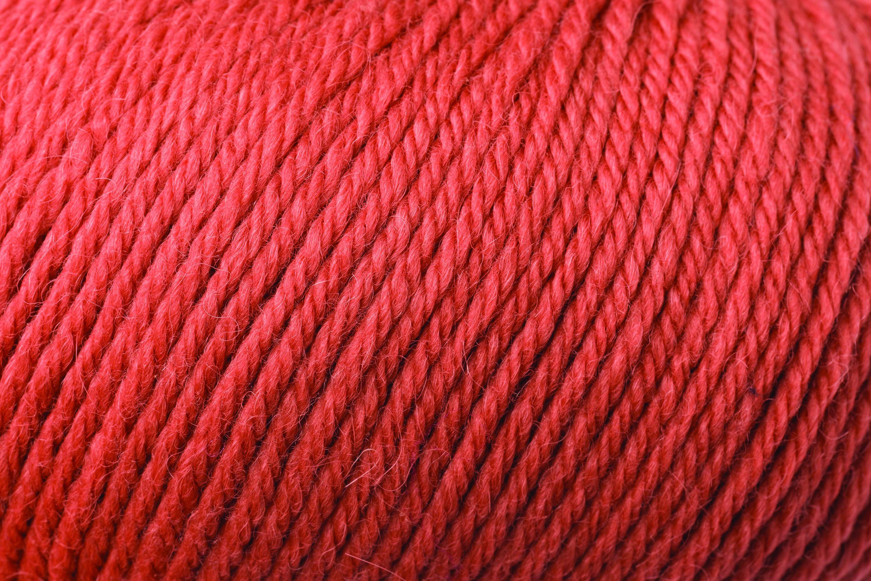 Close up image of yarn Rowan Alpaca Soft DK shade Brick soft orange