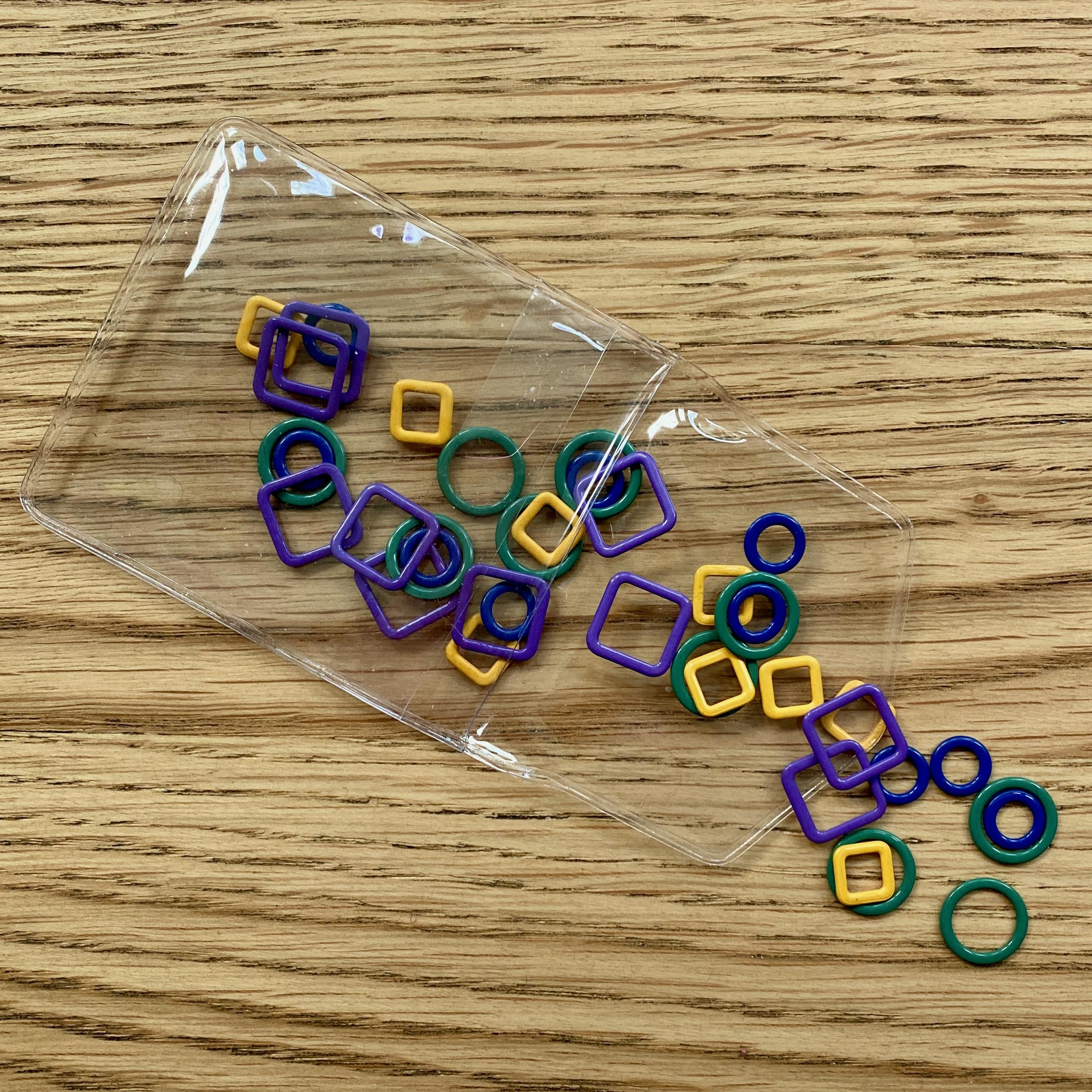 Green Yellow's Purple and blue stitch markers falling out of packaging knit pro
