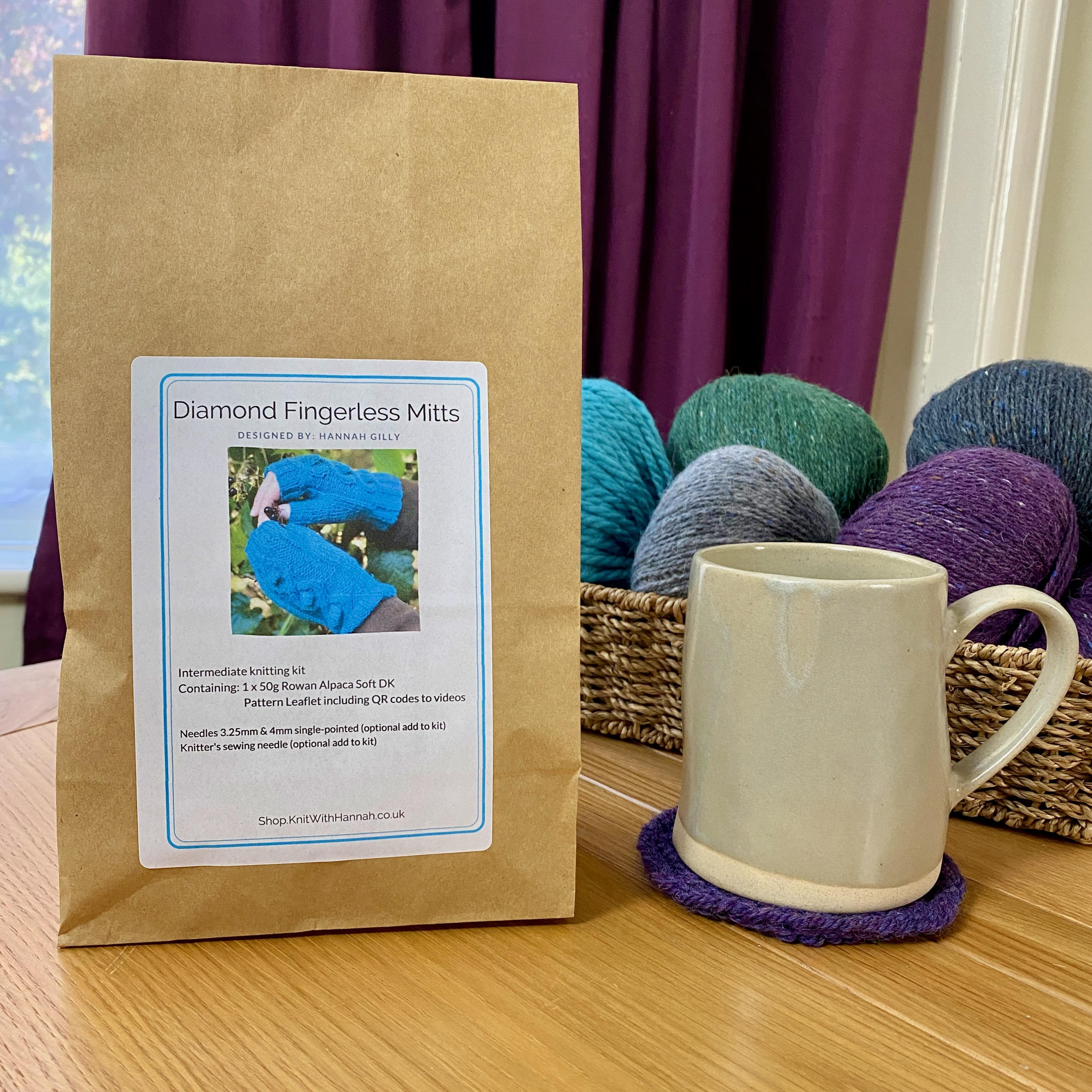 closed knitting kit, in paper bag with cup of tea on wooden table